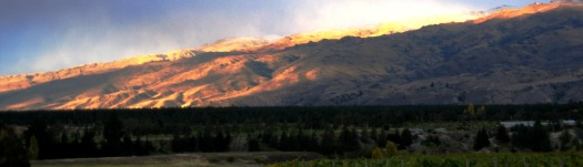 Sun setting over the mountains- a view from the vineyards.